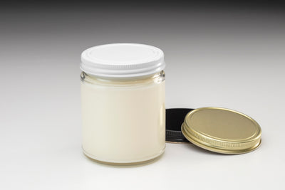 Fair trade and soy blend glass jar candles made ethically in the U.S. by women artisans.