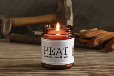 Guy Territory Candle smoke scented with peat and whiskey. Fun ethical gift for fathers, husbands, friends, and partners that gives back.