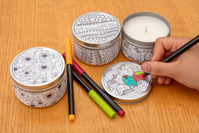 Doodle candles are soy blend travel candles featuring fun drawing to color. Each fair trade candle is hand poured by a woman refugee in the United States. Best gift for a ten or adult looking to relax, with a give back component.