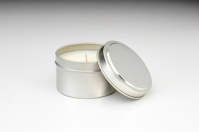 Fair trade and soy blend travel tin candles made ethically in the U.S. by women artisans.