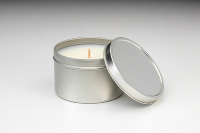 Soy blend travel tin candles made in the U.S. that give back to women artisans.