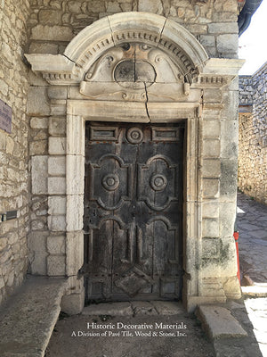 A French limestone and carved wood door, Provence, France