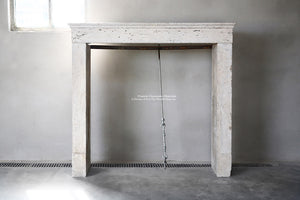 19th Century French Limestone Campagnarde Style Fireplace Mantel