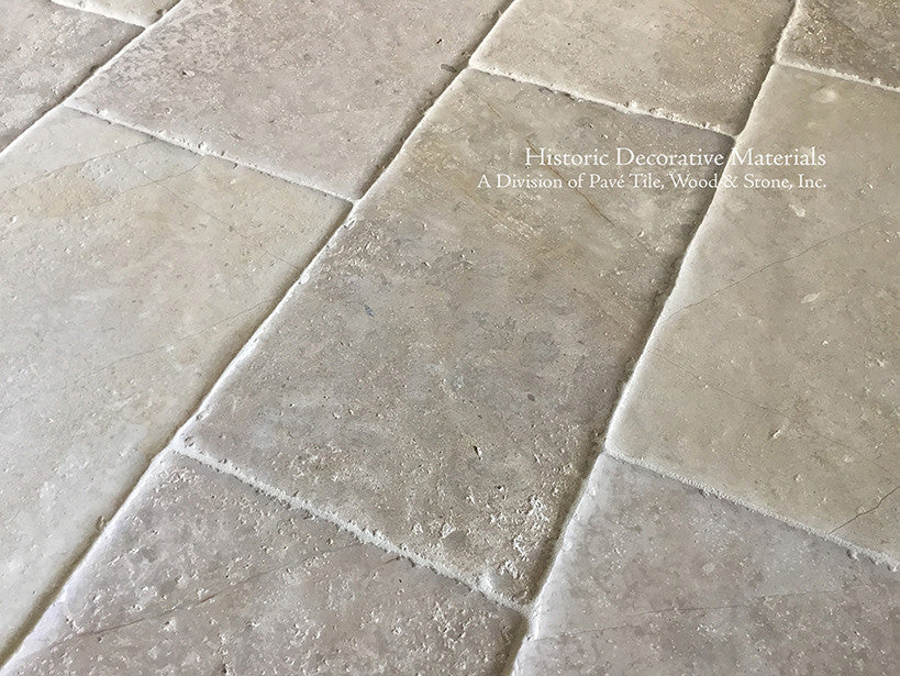 Aged French Limestone Flooring from France loved by architects for kitchen and baths.