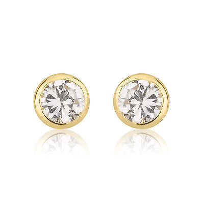14 KT Baby CZ's screw back earrings Yellow
