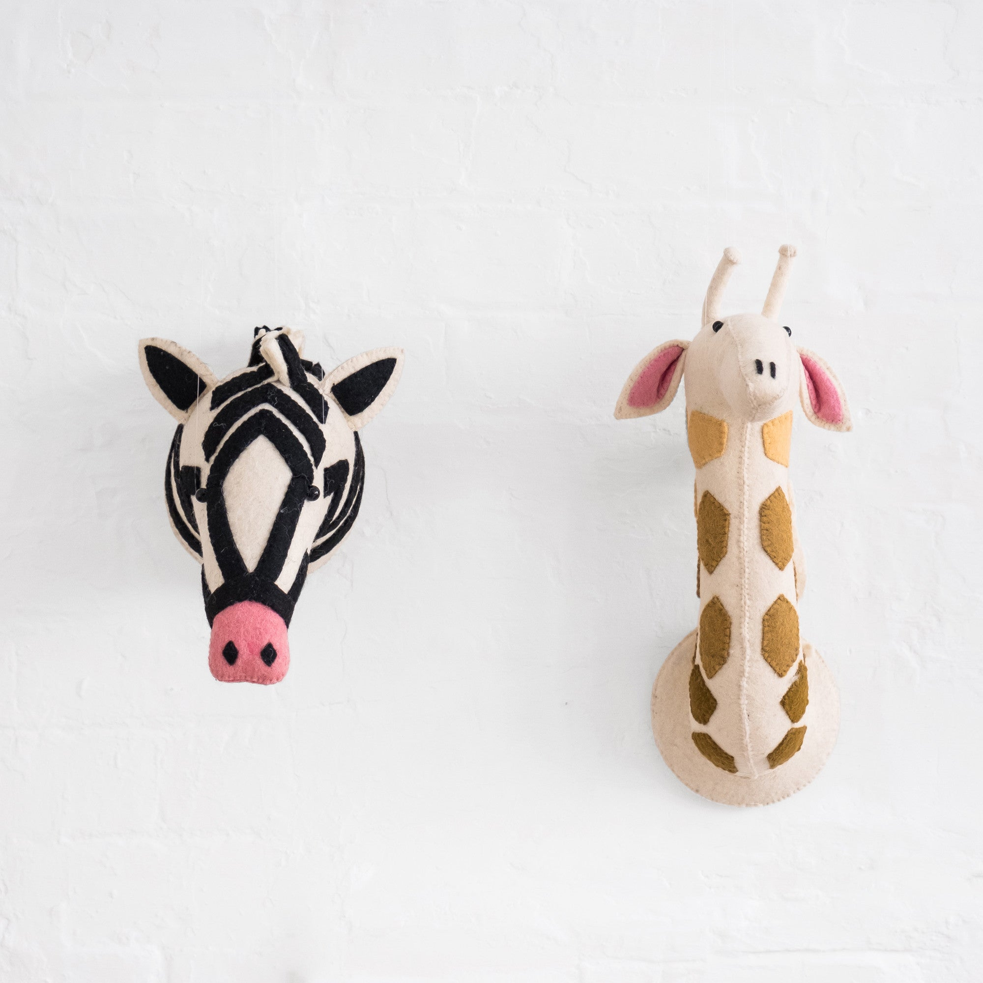 Felt Zebra Head and Felt Giraffe Head by Fiona Walker England, available at Bobby Rabbit.
