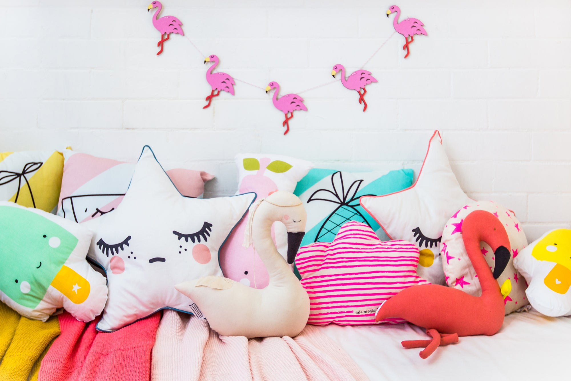 Cushions and Flamingo Garland, all available at Bobby Rabbit (room styling by Bobby Rabbit).