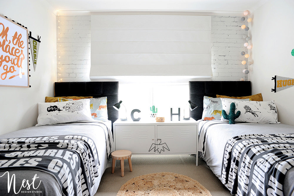 Boys' shared bedroom, created by Nest Design Studio and featured on Bobby Rabbit.