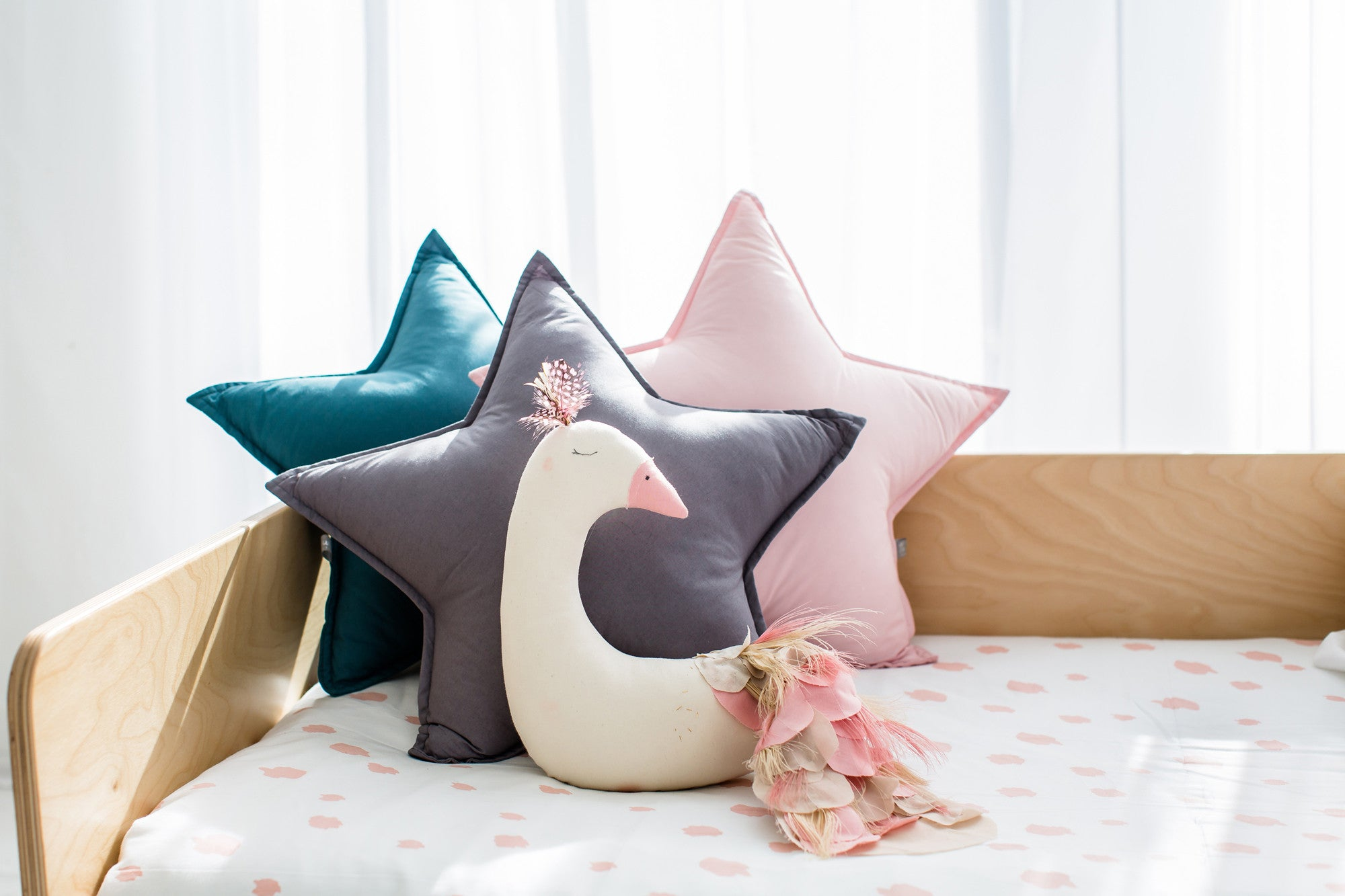 Star cushions and peacock decoration, available at Bobby Rabbit.