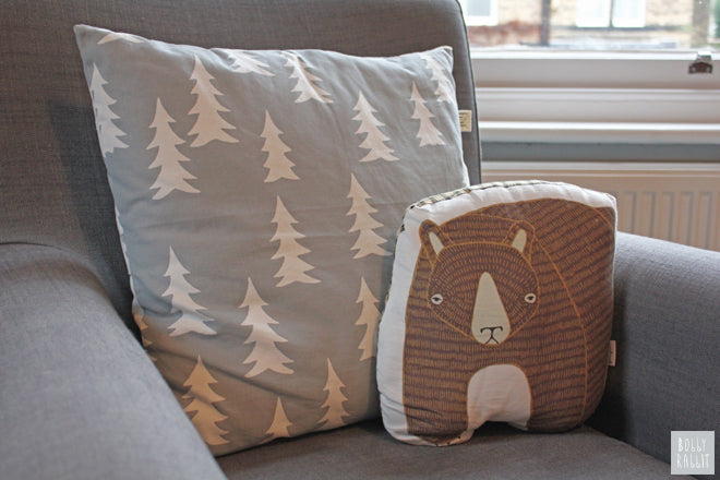 'Gran' tree cushion by Fine Little Day and 'Big Bear' cushion by Gingiber, room design and styling by Bobby Rabbit