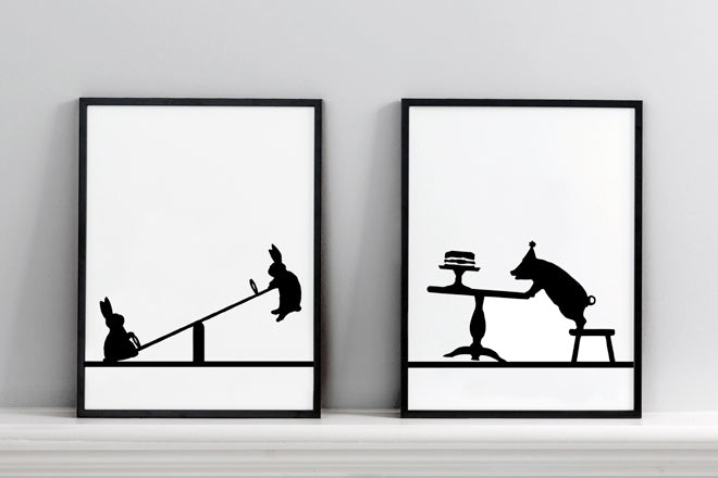 'Seesawing Rabbit' and 'Partying Pig' wall art prints by Ham, published by Bobby Rabbit