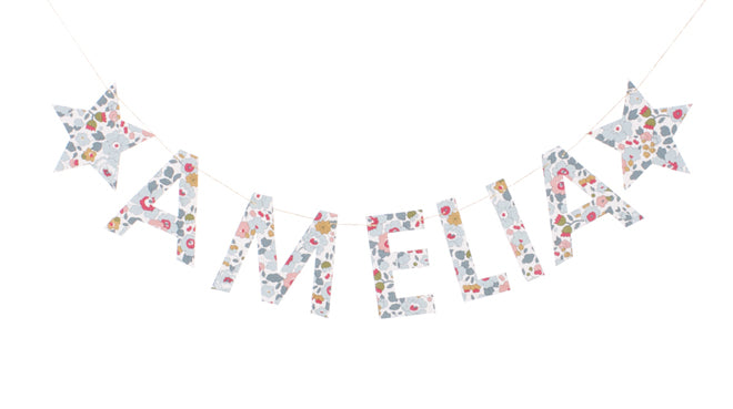 Children's personalised name garland made from liberty print fabric by Little Cloud, published by Bobby Rabbit