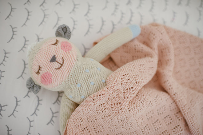 Bla Bla Kids sleepy head play mat and Wooly the Sheep knitted soft toy, available from Molly-Meg and published by Bobby Rabbit