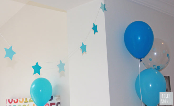 My Little Day 'Blue Star Garland' and balloons from Molly Meg, published by Bobby Rabbit