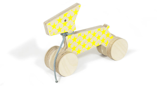 Studio delle Alpi 'Enzo' pull-along dog, neon yellow star print, available from Molly-Meg and published by Bobby Rabbit