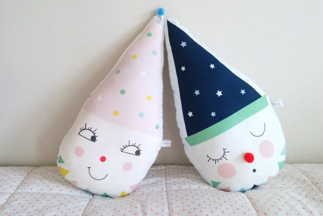 Clown cushions in pink and blue by Pompon Petillant, available at Petit Home, published by Bobby Rabbit
