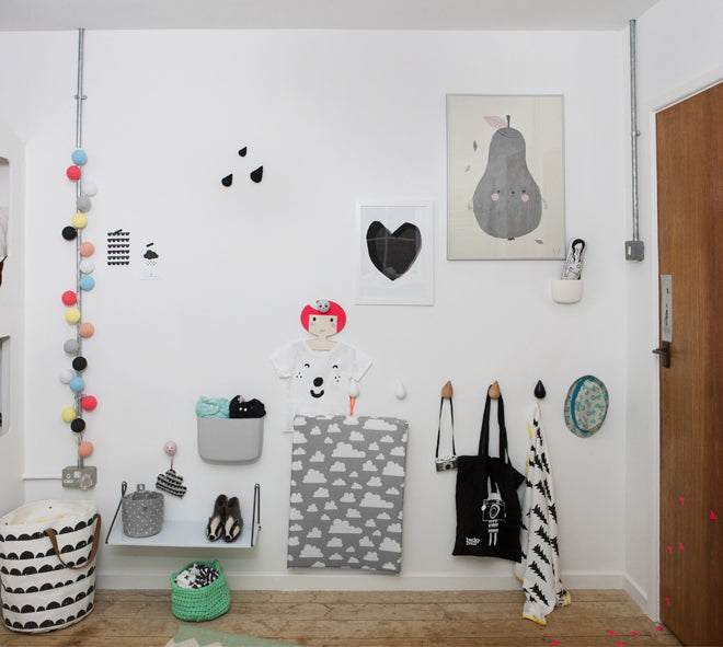 Wall art and wall hooks, shared children's bedroom designed by This Modern Life, published by Bobby Rabbit