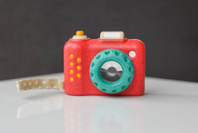 Wooden 'My First Camera' toy by PlanToys and available at Toyella, published by Bobby Rabbit
