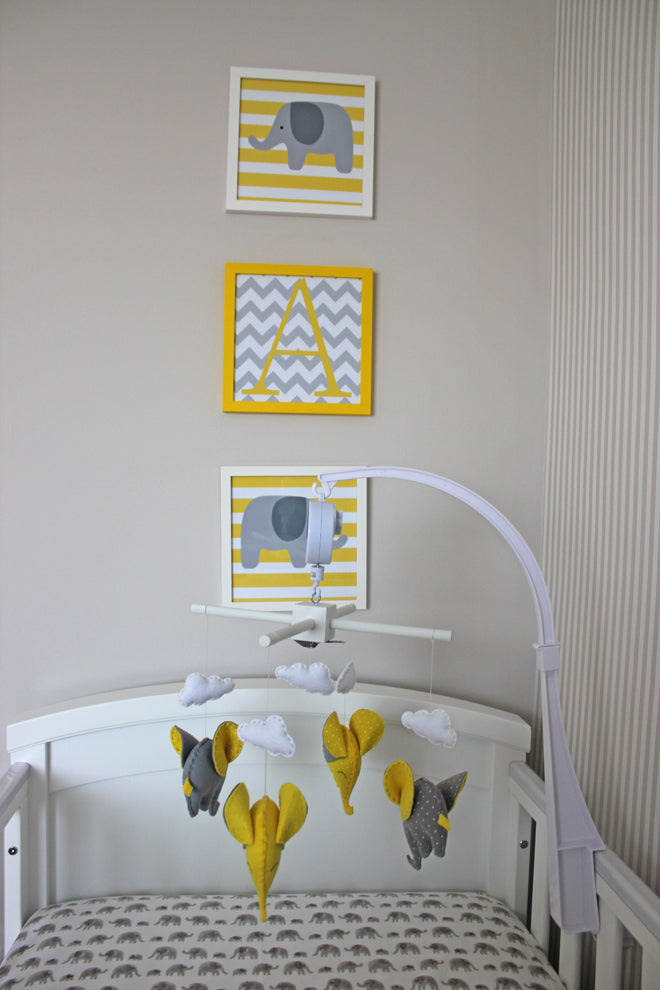 Dream Clouds and Elephants Grey and Yellow Nursery, nursery design by Bobby Rabbit