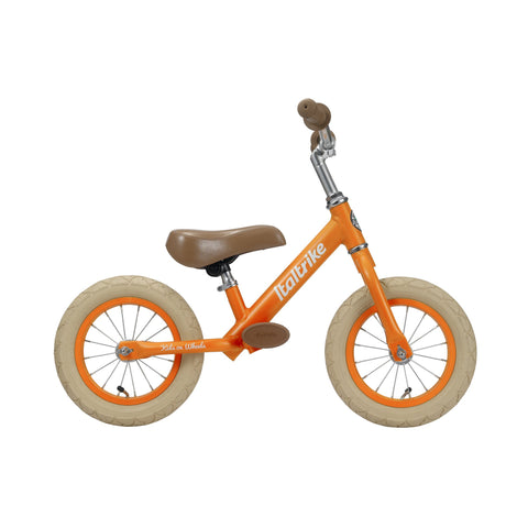 Bright Orange 'Fruits' Balance Bike by Italtrike, available at Bobby Rabbit.
