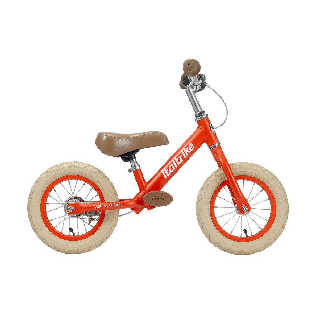 Cherry Red 'Fruits' Balance Bike by Italtrike, available at Bobby Rabbit.