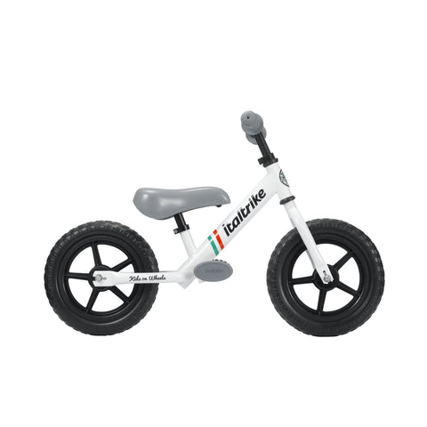 White 'Pista' Balance Bike by Italtrike, available at Bobby Rabbit.