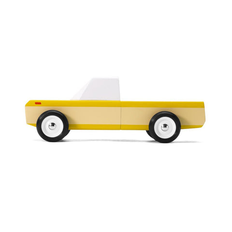 Orange Longhorn wooden vehicle by Candylab, available at Bobby Rabbit.