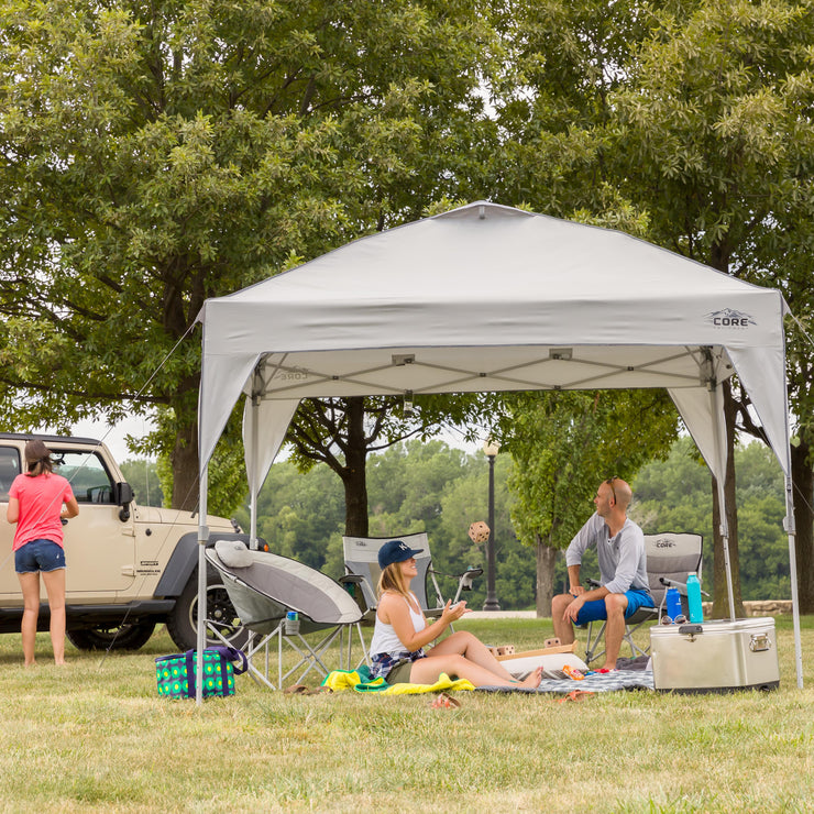 Core Equipment 10x10 Instant Canopy lifestyle image of friends in a park