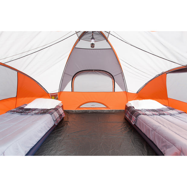 Core Equipment 9 Person Extended Dome Tent Interior with two cots and lantern hanging from gear loft