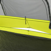 Image of oversized adjustable ground air vents, vent is open, staked out, with an adjustable drawstring accessible from inside tent