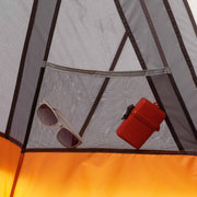 Image of a gear pocket inside tent with items placed inside
