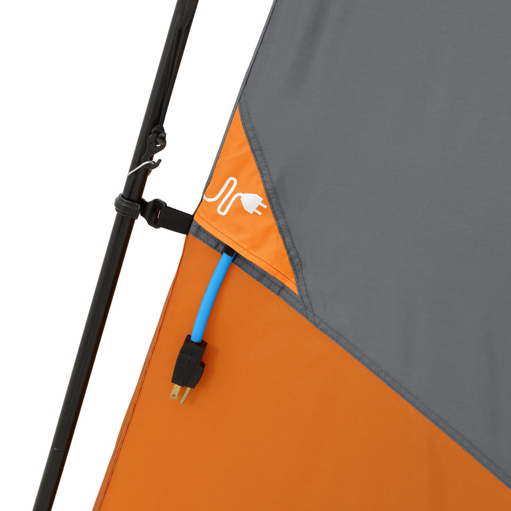 Electrical port on outside of tent with cord fed through opening