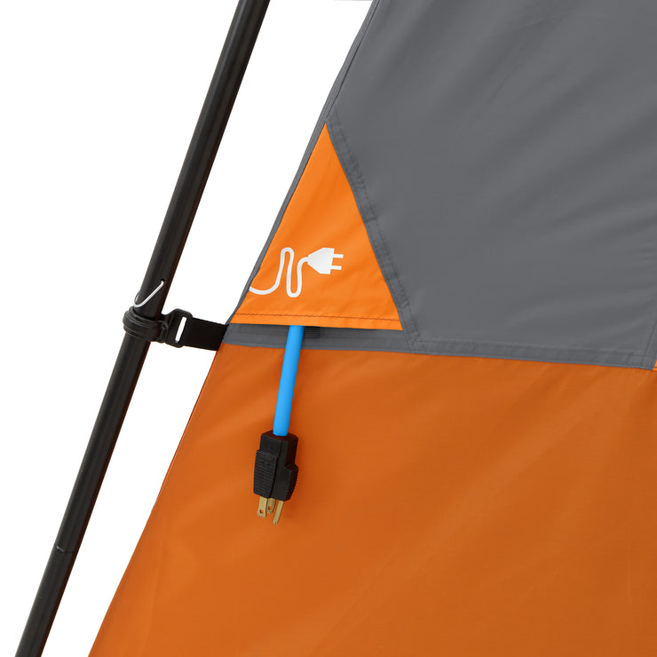 Electrical cord port on outside of tent with cord fed through opening