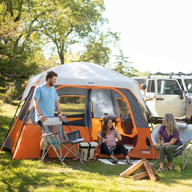 Lifestyle image of friends camping in 6 person straight wall cabin tent