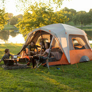 Lifestyle image of friends camping in the 6 person straight wall cabin tent with screen room