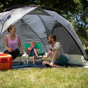 Lifestyle image of 8x8 Instant Sport Shade Dark version with family at park enjoying shade with side panels fully zipped