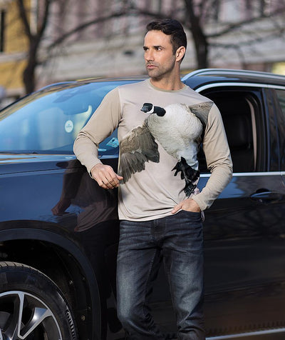Man with Canada Goose t-shirt Landing