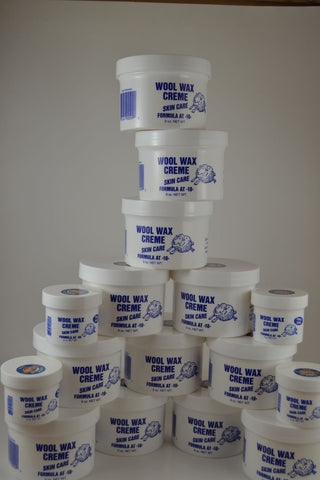 12 nine ounce jars and 4 two ounce jars Wool Wax Creme