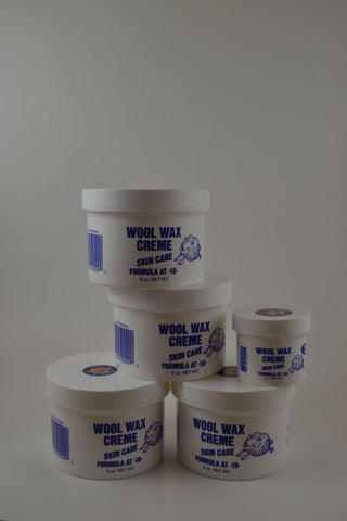 4 Nine ounce jars and 1 two ounce jar Wool Wax Creme