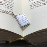 Hand engraved book charm on fine filed trace neckchain