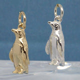 Gold and silver penguin charms
