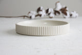 Ceramic large bowl in white with curved line pattern