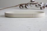 Modern ceramic white oval bowl with curved line pattern