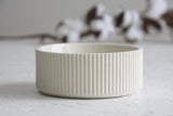 Ceramic small bowl in white with curved line pattern