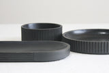 Modern ceramic black oval bowl in black curved line pattern