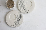 Eve - Ceramic espresso cup and saucer in white and black lines pattern