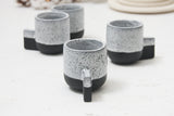 Lenny- Ceramic espresso cup in black with white glaze and black dots pattern