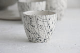 Lili - ceramic espresso cup in white and black lines pattern