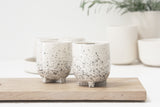Plus- Ceramic esspreso cup in white and black dots pattern