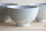 LILI - Ceramic bowl in light blue & white marbled look